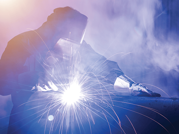 Armor Contract Manufacturing Worker Fabrication Welding in Shop
